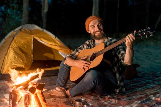 guitarist-camping-night-by-campfire_23-2148223488