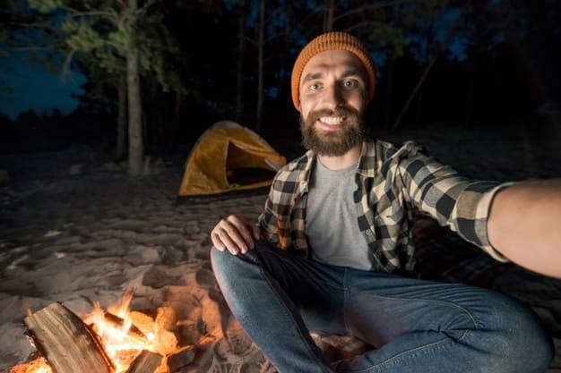 selfie-man-camping-by-firecamp_23-2148223509