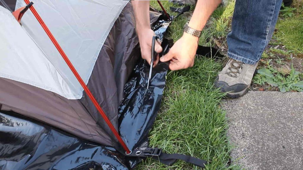 cutting a tent footprint with a scissor
